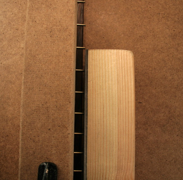 Bevel the frets with a homemade fret beveling file