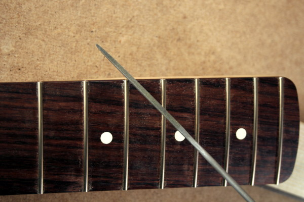 Round the fret ends with homemade fret end dressing file
