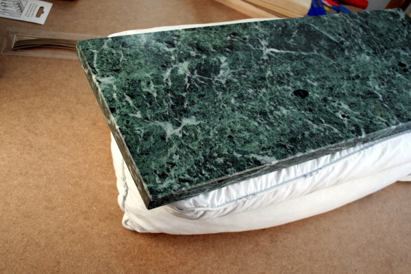 A slab of marble with a pillow underneath to absorb the blows